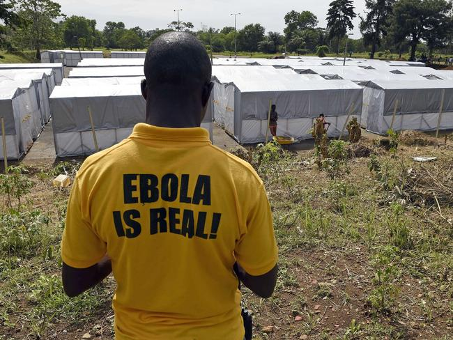 A man inspects a new treatment centre as part of the fight against the deadly Ebola virus in Liberia. Picture: AFP/Pascal Guyot