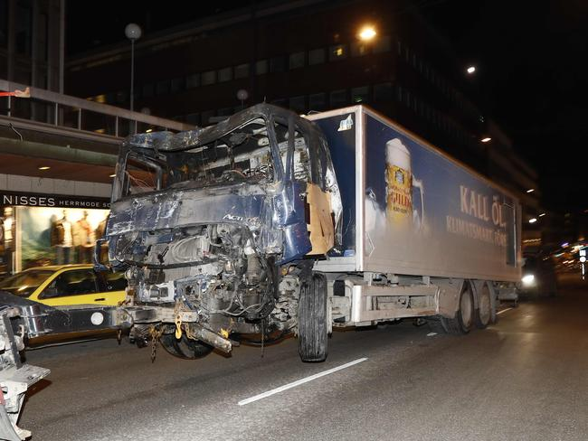 The stolen truck used in the attack is towed from the scene. Picture: AFP