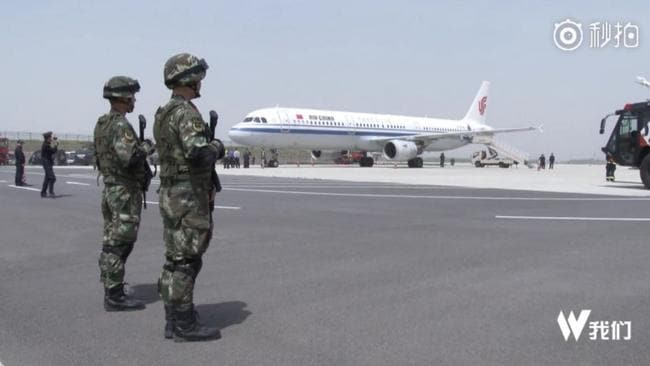 Armed officers greeted the plane when it arrived in Zhengzhou. Picture: Shanghaiist