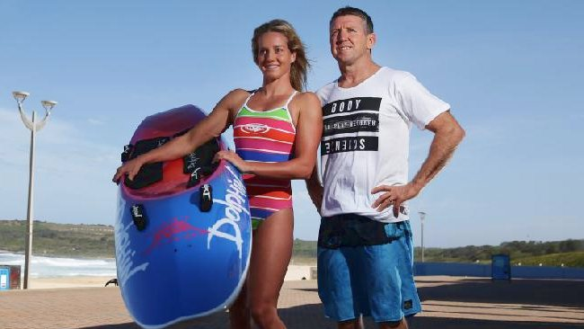 """Ironwoman Tara Coleman with her father Craig """"Tugger'' Coleman on Maroubra beach. Picture: Brett Costello"""