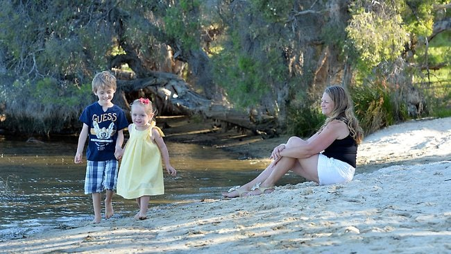 Julie Granville and children Georgia, 3, and Charlie, 5, at Thomas Middleton Park in Brentwood. Picture: Stewart Allen
