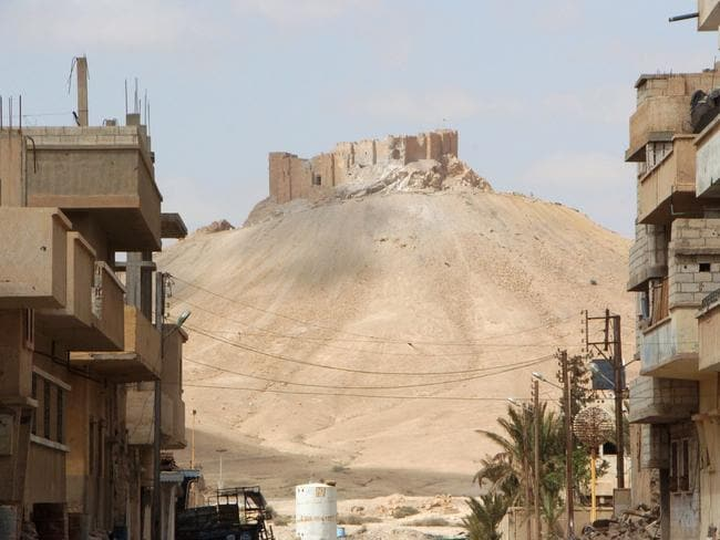 The citadel of the ancient city of Palmyra as seen from a residential neighbourhood of the modern town after Syrian troops recaptured the city.
