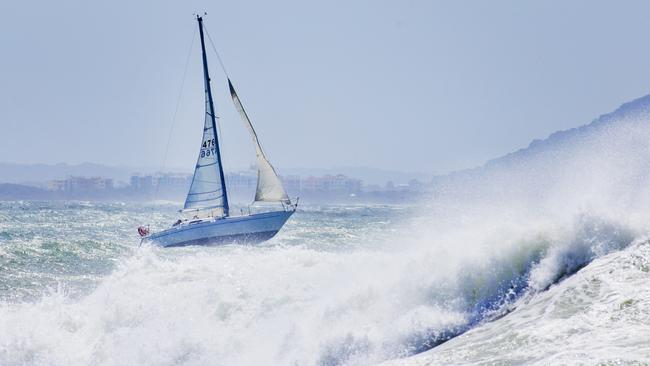 A yacht heads out into rough seas off Mooloolaba in Queensland despite gale-force wind warnings as ex-Tropical Cyclone Linda heads towards the Sunshine Coast. Picture: Lachie Millard
