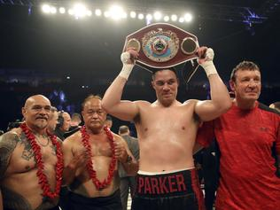 New Zealand's Joseph Parker celebrates his points victory over Britain's Hughie Fury after the WBO heavyweight title bout Saturday, Sept. 23, 2017 at Manchester Arena in Manchester, England. Joseph Parker of New Zealand retained his WBO heavyweight title by beating Hughie Fury of Britain in a majority decision on Saturday. (Nick Potts/PA via AP)