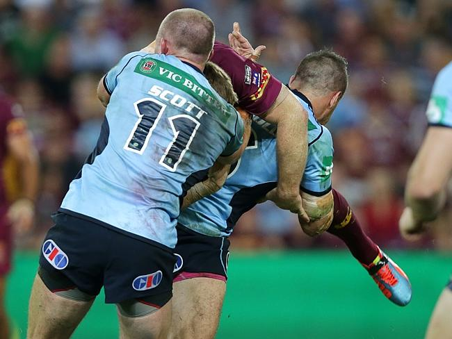 Josh Reynolds was placed on report for this tackle on Brent Tate.