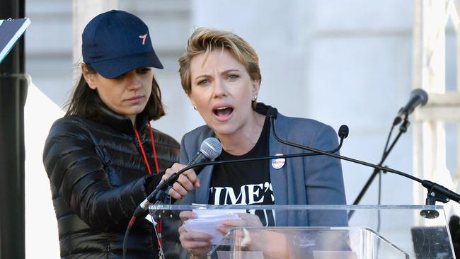 Mila Kunis supports Scarlett Johansson as she speaks during the Women's March in Los Angeles where she zeroed in on James Franco. Picture: Chelsea Guglielmino/Getty Images.