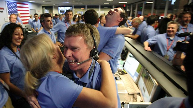 August 6: Curiosity, a nuclear-powered American-built robot, lands on the planet Mars and starts an ambitious exploration mission. The rover has since sent back a number of photos of the red planet. 05/08/2012 WIRE: Telecom engineer Peter Ilott (C) hugs a colleague, celebrating a successful landing inside the Spaceflight Operations Facility for NASA's Mars Science Laboratory Curiosity rover at Jet Propulsion Laboratory (JPL) in Pasadena, California on August 5, 2012. NASA's 2.5 billion USD Mars rover Sunday made a dramatic touchdown on the Red Planet, marking a successful end to the most sophisticated Mars attempt in history. Picture: AFP