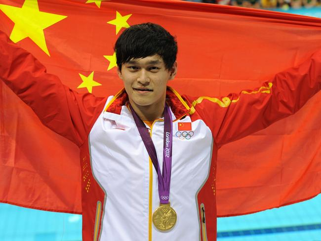 Sun Yang celebrates after smashing Grant Hackett's 1500m record to win gold at the London Olympics in 2012.