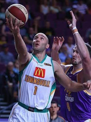 Townsville's Steven Markovic goes toe-to-toe with AJ Ogilvy of the Kings. Picture: Joosep Martinson