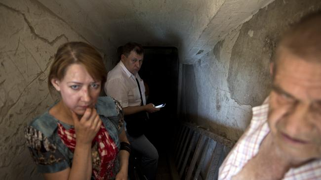 Shelter ... locals in Donetsk seek refuge in the basement of a school near the train station. Picture: Ella Pellegrini
