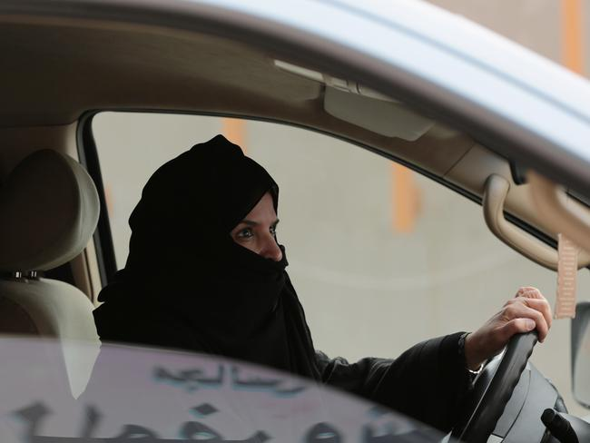 Protest ... Aziza Yousef drives a car on a highway in Riyadh, Saudi Arabia, as part of a campaign to defy Saudi Arabia's ban on women driving. Picture: Hasan Jamali, AP