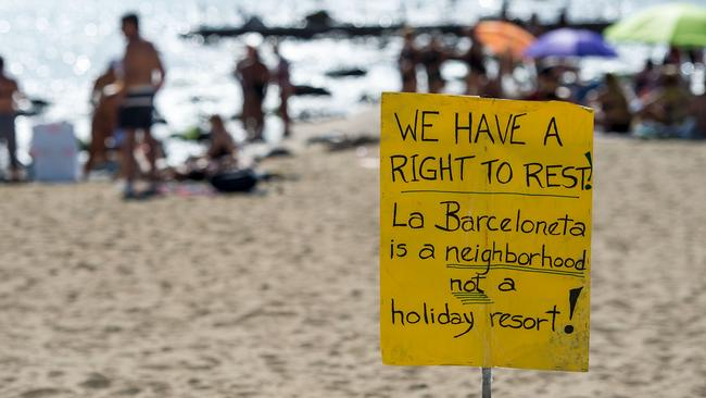 "A protest-placard on La Barceloneta beach during a demonstration against ""drunken tourism"" called by the residents of La Barceloneta neighbourhood in Barcelona, on August 12, 2017. Picture: AFP / Josep Lago."