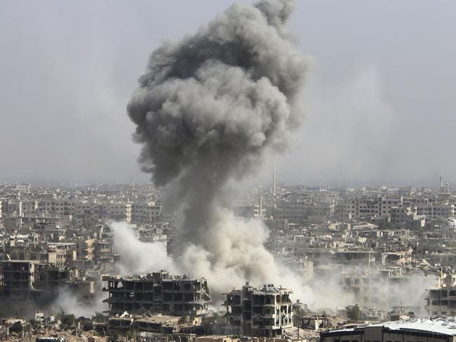 Smoke rises after shelling by the Syrian army last week in Jobar, Damascus, Syria. Backed by Russian air strikes, the Syrian army has launched an offensive in central and north-western regions. Picture: Alexander Kots/Komsomolskaya Pravda via AP