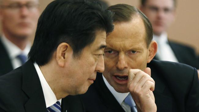 Closer ties upset China ... Japan's Prime Minister Shinzo Abe, left, listens to Australian Prime Minister Tony Abbott during a meeting with members of Abbott's cabinet on national security at Parliament House. Picture: Jason Reed