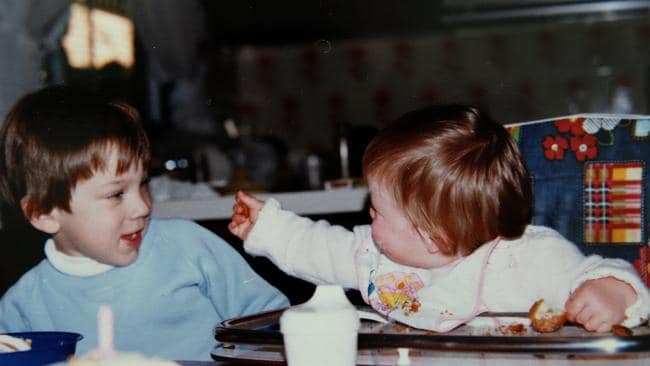 Tracy Thomas and brother Kurt Lee at the family dining table as children.