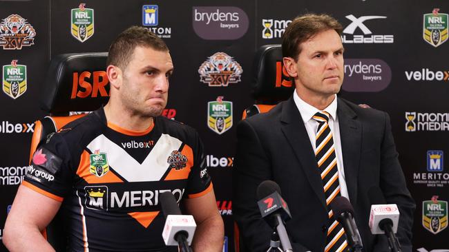 Wests Tigers coach Mick Potter talks during a press conference with Robbie Farah.