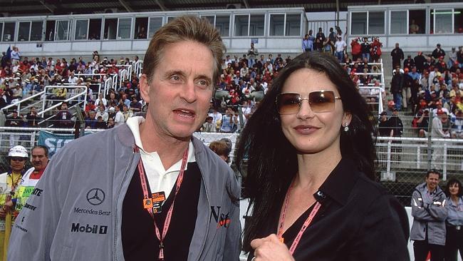 Michael Douglas and wife Catherine Zeta-Jones visit an F1 grand prix. Good taste.
