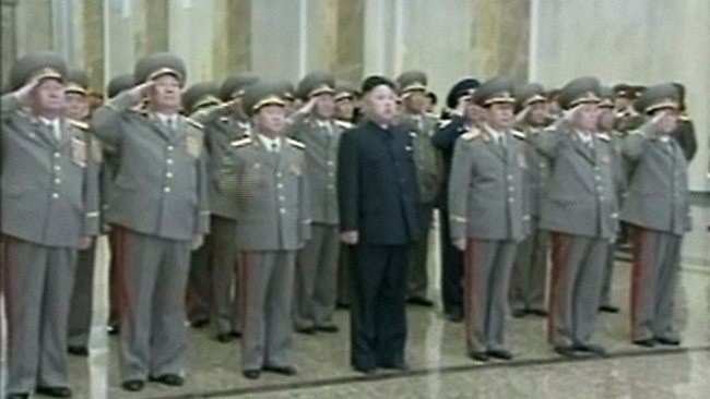 In this April 15, 2013 image made from video, North Korean leader Kim Jong Un, center, accompanied by North Korean soldiers visits Kumsusan Palace of the Sun in Pyongyang, North Korea. North Koreans celebrated the birthday of their first leader Monday by dancing in plazas and snacking on peanuts, with little hint of the fiery language that has kept the international community fearful that a missile launch may be imminent. (AP Photo/KRT via AP Video) TV OUT, NORTH KOREA OUT