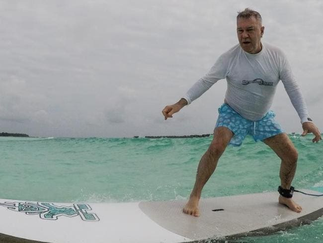 Barnes recently learned how to surf while on holiday in the Maldives. Picture: Instagram/Jimmy Barnes