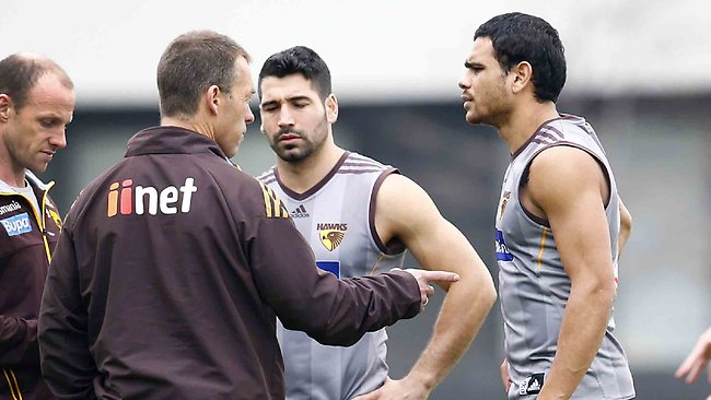 Alistair Clarkson talks with Paul Puopolo and Cyril Rioli before training on Tuesday. Picture: Michael Klein