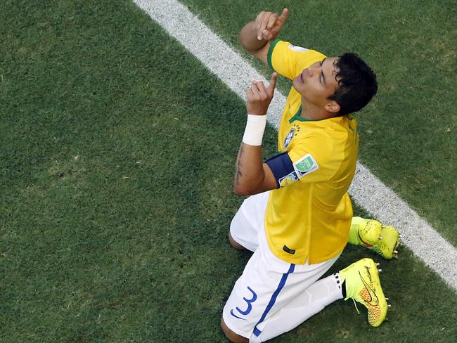 Brazil's Thiago Silva celebrates after scoring his side's first goal during the World Cup quarter-final against Colombia.