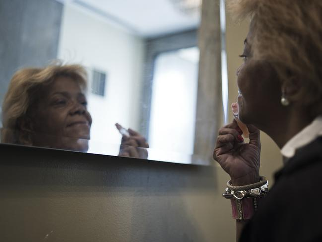 A woman putting on makeup before she left for work early one morning. Picture: Felipe Paiva/Newsmodo