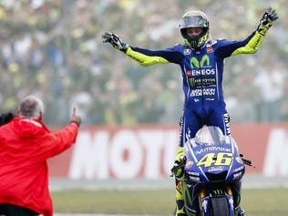 TOPSHOT - Italy's Valentino Rossi celebrates after winning the Assen Motorcycling Grand Prix at the TT circuit in Assenon on June 25, 2017. / AFP PHOTO / ANP / Vincent Jannink / Netherlands OUT