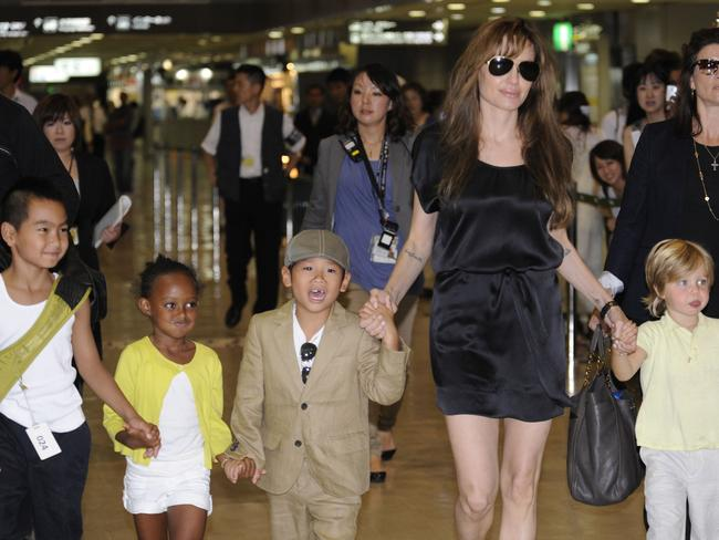 Angelina Jolie (2R), accompanied by her children Maddox (L), Zahara (2L), Pax (3L) and Shiloh (R). Picture: AFP