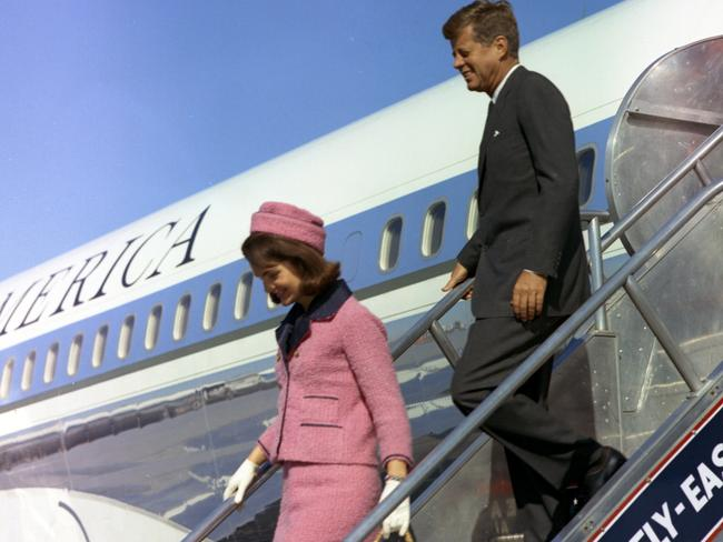 John F Kennedy and wife Jackie descend the stairs from air force One at Love Field in Dallas, Texas on November 22, 1963. Picture: Supplied