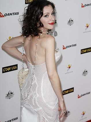 Tina Arena looked stunning in this white J'Aton creation.