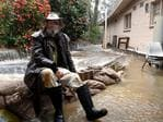 Aldgate RSL president Ian Campbell watches on as the water flows in. Picture: Tricia Watkinson