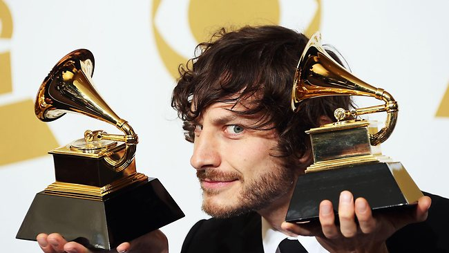 A handful . . . Gotye posing with two of three of his trophies.