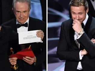 Oscars 2017 .. 'La La Land' producer Jordan Horowitz holds up the winner card reading actual Best Picture winner 'Moonlight' with actor Warren Beatty onstage during the 89th Annual Academy Awards. Picture: Getty