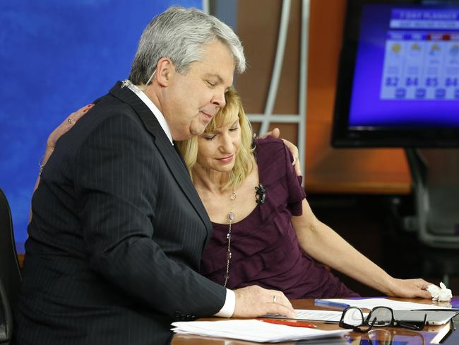 Tragedy ... WDBJ-TV7 news morning anchor Kimberly McBroom, centre, gets a hug from visiting anchor Steve Grant. Picture: AP Photo/Steve Helber