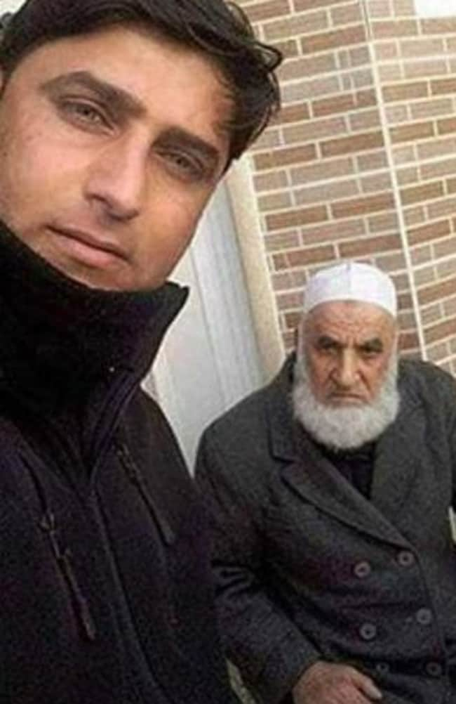Members of the security forces took selfies with the captured terror suspect. Picture: ABNA 24