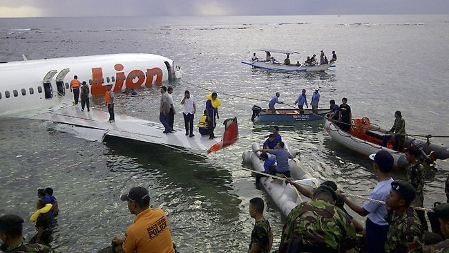 This photo released by Indonesia's National Rescue Team shows rescuers at the crash site of a Lion Air plane in Bali, Indonesia.