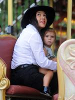 Kourtney Kardashian and daughter Penelope Disick ride the merry go round by the Eiffel tower after dinner at L'Avenue. Picture: Splash