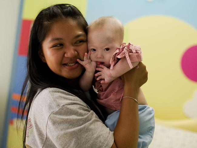 Meant to be in Western Australian ... Thai surrogate mother Pattaramon Chanbua (L) holds baby Gammy who she claims was rejected due to his Down syndrome. Picture: AFP