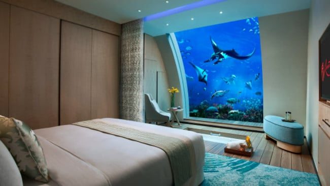 "The ocean suites at Singapore's Resorts World Sentosa offer underwater views into the world's largest aquarium. There's 11 suites to choose from, and guests can watch the sea life from their bathtubs or beds. Picture:  <a href=""http://www.rwsentosa.com/language/en-US/Homepage/HotelsAndSpa/OceanSuites"" target=""_blank"">Resorts World Sentosa Singapore</a>"
