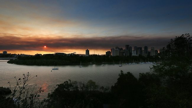 Smoke hangs over Brisbane City from the fires. Pic: Adam Armstrong