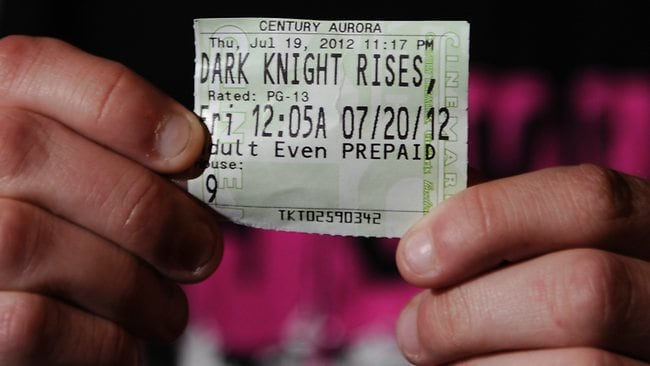 Brittany Diemer shows the ticket stub for the Dark Knight Rises session which saw a gunman open fire in a cinema in Aurora, Colorado. Picture: AP / The Denver Post, Karl Gehring
