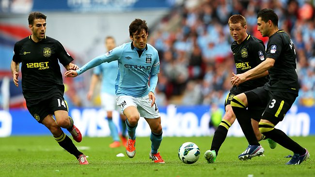FA CUP FINAL. Wigan Athletic 1 d Manchester City 0 at Wembley. David Silva of Manchester City is watched by Jordi Gomez (L), James McCarthy (2R) and Antolin Alcaraz. Picture: Alex Livesey