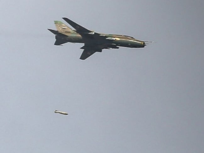 "A Syrian Su-22 ""Fitter"" is pictured here dropping a bomb. US Navy F/A-18 Super Hornets engaged aircraft like this after an attack on allied positions south of Raqqa."