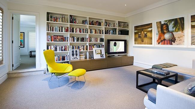 A spacious and light informal room at carrington Ave, perfect for relaxing with family.