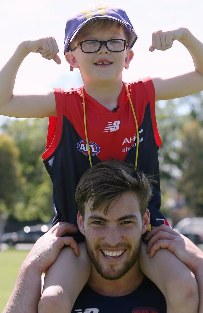 Jack Viney with nine-year-old Andrew Jeffery. Picture: Wayne Ludbey