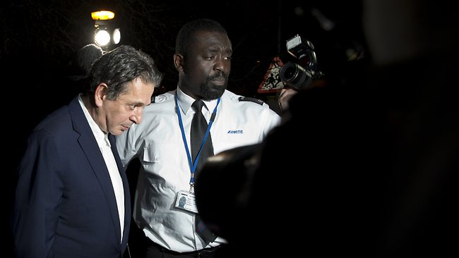 Charles Saatchi, flanked by a security guard, leaves Isleworth Crown Court in London. Picture: AP