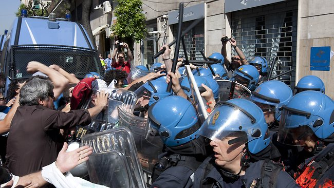 No retreat: Austerity protests like this one in Naples show that Europe remains volatile. Picture: AFP