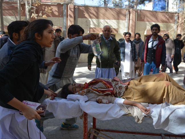 Paramedics attend to an injured victim after suicide bombers attacked a Methodist church during a Sunday service in Quetta. Picture: AFP/Banaras Khan