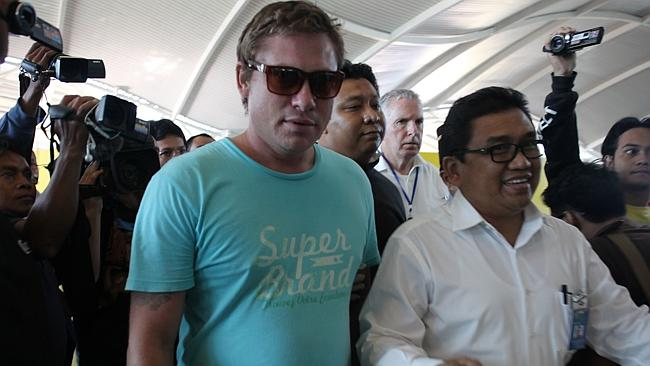 Australian Matt Lockley escorted to Ngurah Rai Airport to go back to Brisbane yesterday. Lockley was arrested over an incident on a Virgin flight from Brisbane to Bali on Anzac Day.