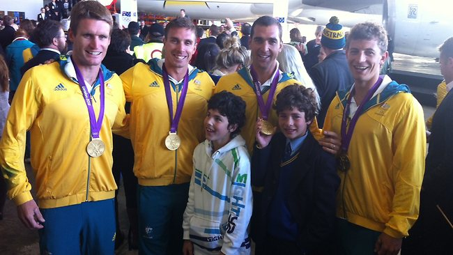 Gold medal winning K4 kayakers with well wishers. Picture: Ross Schultz